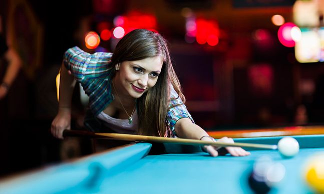 young lady playing billiards
